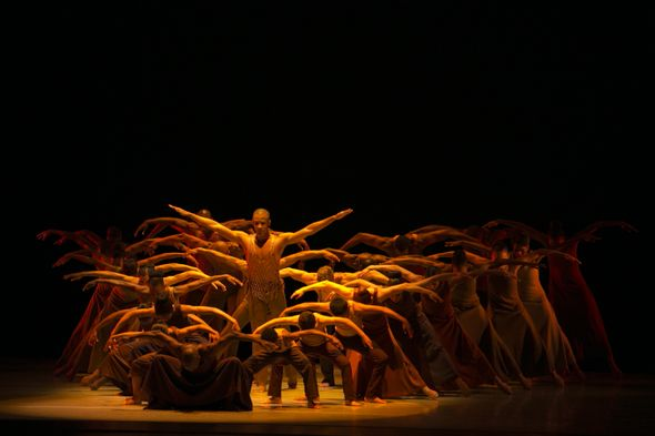 Alvin Ailey American Dance Theater in Alvin Ailey's Revelations with a cast of 50.  Photo by Whitney Browne